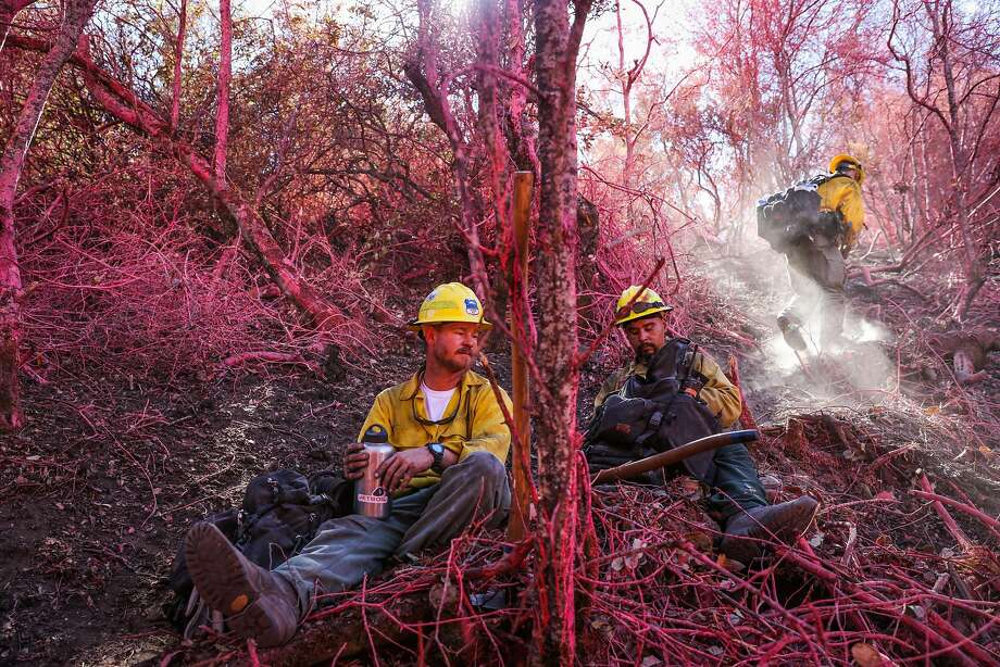 Firefighters John Waybright (left), Pedro Rios (center) and Brent Panos (right) take a lunch break from traversing a forested area while looking for hot spots caused by the Soberanes Fire, in Monterey, California, on Thursday, Sept. 29, 2016. Photo: Gabrielle Lurie, The Chronicle