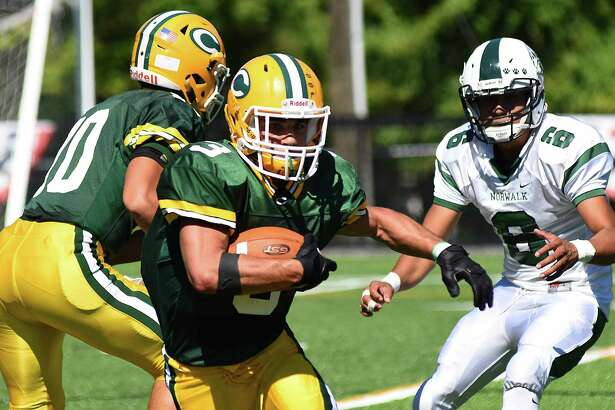 The Trinity Catholic Crusaders opened its new home field, Gaglio Field, on Saturday, Sept. 24, 2016, in Stamford, Conn., hosting Norwalk in an FCIAC football game. The host Crusaders rolled to a 52-28 win over the Bears.