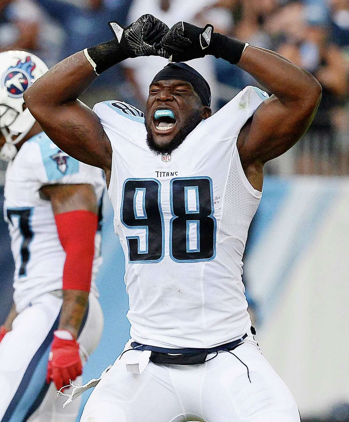 Tennessee Titans outside linebacker Brian Orakpo (98) celebrates his tackle of Carolina Panthers quarterback Cam Newton (1) the first half of an NFL preseason football game, Saturday, Aug. 20, 2016, in Nashville, Tenn. (AP Photo/Mark Zaleski)