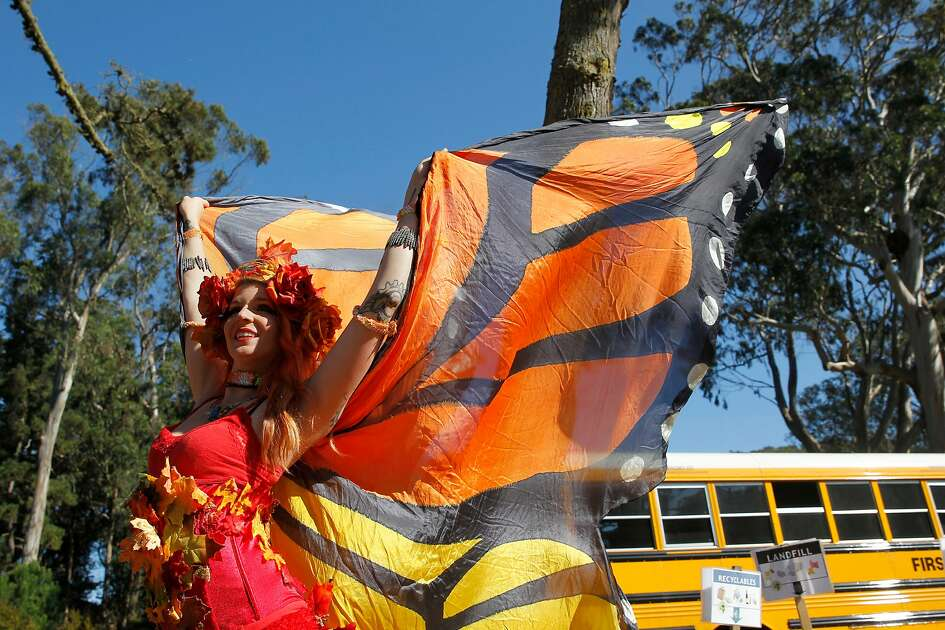 A performer from Cirkus Quirkus greets students before the Poor Man's Whiskey & Cirkus Quirkus kids program at the 16th annual Hardly Strictly Bluegrass Music Festival at Golden Gate Park on Friday, Sept. 30, 2016 in San Francisco, Calif.