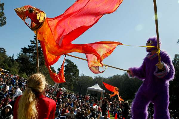 Performers walk through the crowd during the Poor Man's Whiskey & Cirkus Quirkus kids program at the 16th annual Hardly Strictly Bluegrass Music Festival at Golden Gate Park on Friday, Sept. 30, 2016 in San Francisco, Calif.