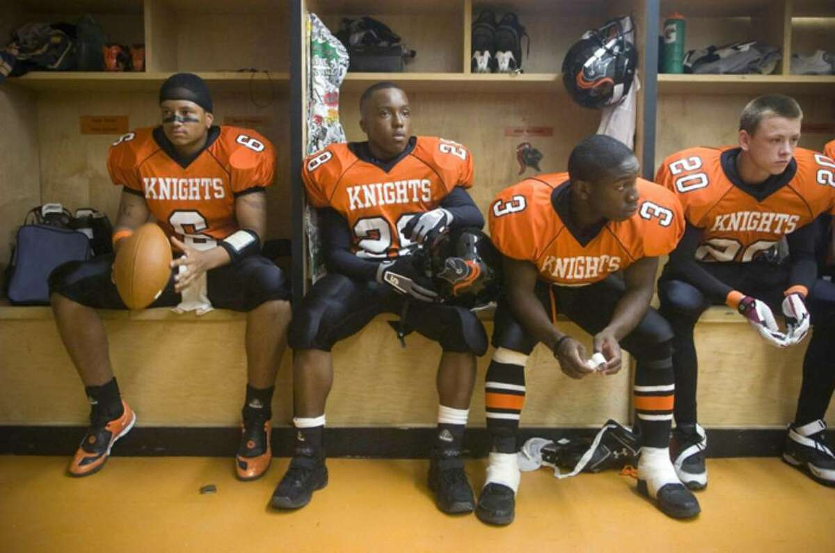 Stamford players, from left, Jalen Holmes, Anderson Boursiqout, Mark Seward and Donnacha O'Dwyer wait in the locker room for the game to start before an FCIAC football game against Ridgefield High School at Stamford High School in Stamford, Conn. on Thursday, Sept. 17, 2009