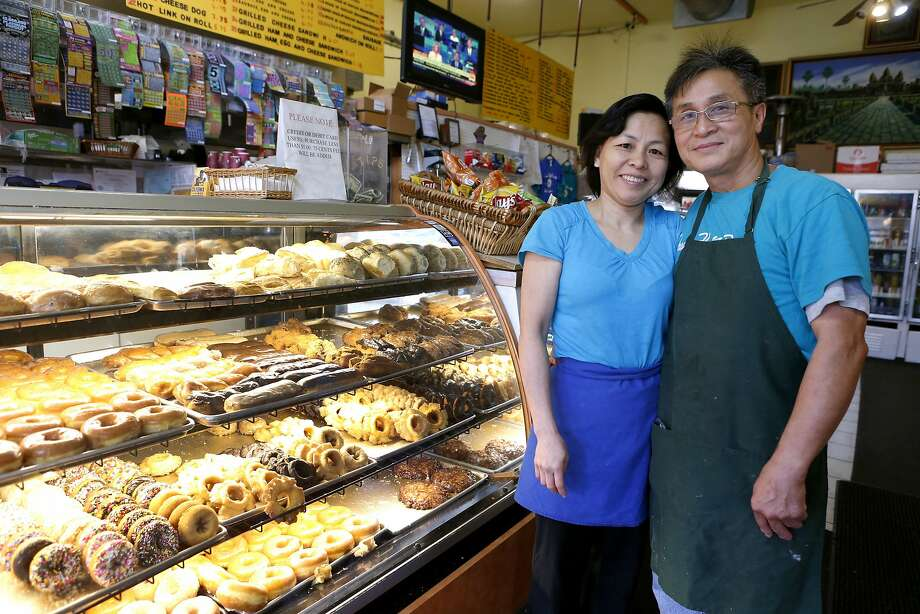 Dream Fluff Donuts owners Nasin Bun and her husband, Alex Sieu, take a brief break after the morning rush at their shop in Berkeley's Elmwood neighborhood. Photo: Paul Chinn, The Chronicle