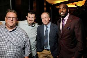 NOT FOR SOCIETY- FOR ALLISON COOK STORY From left: Chris Shepherd, Kevin Floyd, Steve Flippo and Whitney Mercilus at the VIP Dinner for the launch of the Whitney Mercilus foundation WithMerci at DelFrisco's Double Eagle Steakhouse Tuesday Sept. 27, 2016. (Dave Rossman Photo)
