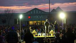 Hundreds gather for a candlelight vigil outside the Cascade Mall on in Burlington, Washington, after five people were shot and killed by a gunman on Sept. 24. The suspect, Arcan Cetin, was initially misidentified as a Hispanic, showing a rush to judgment, according to a reader.