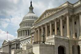 The U.S. Capitol, with the Senate at right and the House of Representatives at far left, is seen in Washington. Gridlock here, particularly in the House, is a direct result of redistricting that allows elected officials to choose their voters rather than voters choose their represenatives.