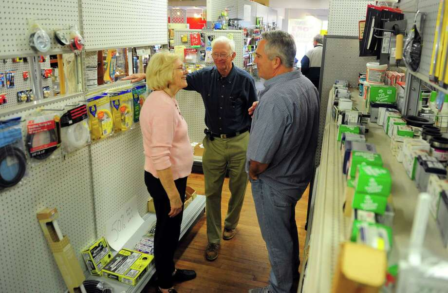 Ron Clough, center, and his wife Evelyn chats with Dave McNeil at Clough's Hardware on Main Street in Stratford, Conn., on Friday Sept. 30, 2016. After 83 years in business Clough's Hardware closed its doors for the last time today. Photo: Christian Abraham, Hearst Connecticut Media / Connecticut Post