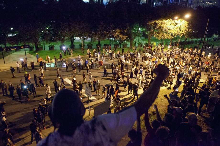 Protesters climb the banks near the roadway leading to Interstate 277, which they temporarily shut down, in Charlotte, N.C., Sept. 22.. The unrest began after Keith Scott was killed by the police here. The demonstrations were largely peaceful, but included some rioting and the death of a protester. Photo: ANDY MCMILLAN /NYT / NYTNS