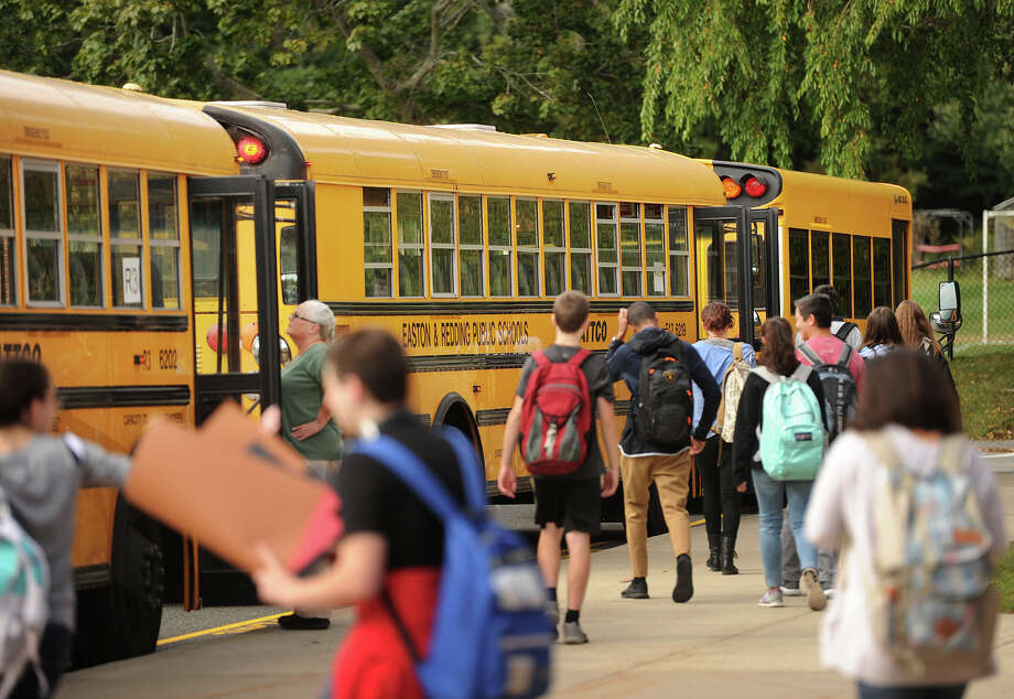Students head for the buses at Joel Barlow High School in Redding, Conn. on Thursday, September 29, 2016. Photo: Brian A. Pounds / Hearst Connecticut Media / Connecticut Post