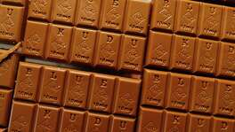 Candy bars marked with Colorado's new required diamond-shaped stamp noting that the product contains marijuana are shown in the kitchen of BlueKudu candy in Denver. State officials require the stamp to be put directly on edibles after complaints that the treats look too much like their nonintoxicating counterparts.
