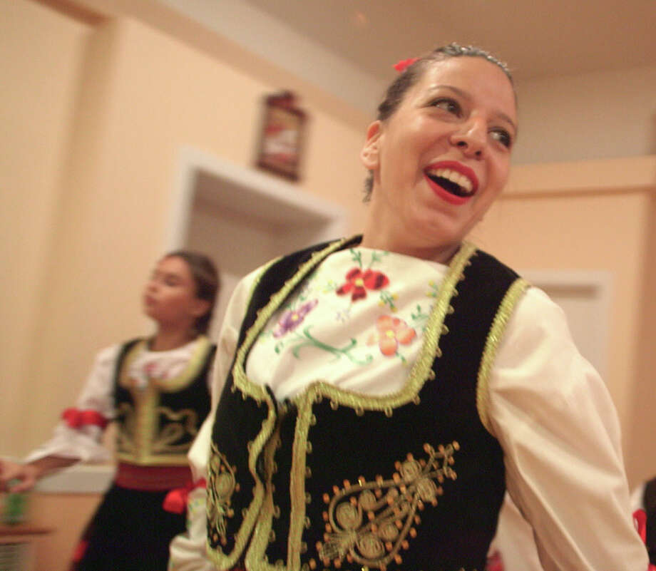 """For her second season of her show """"Bare Feet with Mickela Mallozzi,"""" the Stamford native steps her way through the neighborhoods of New York City through dance and music. Here, she takes part in a traditional dance at the Serbian Social Club in Ridgewood, Queens. Photo: Lina Plioplyte / Contributed Photo / Lina Plioplyte"""