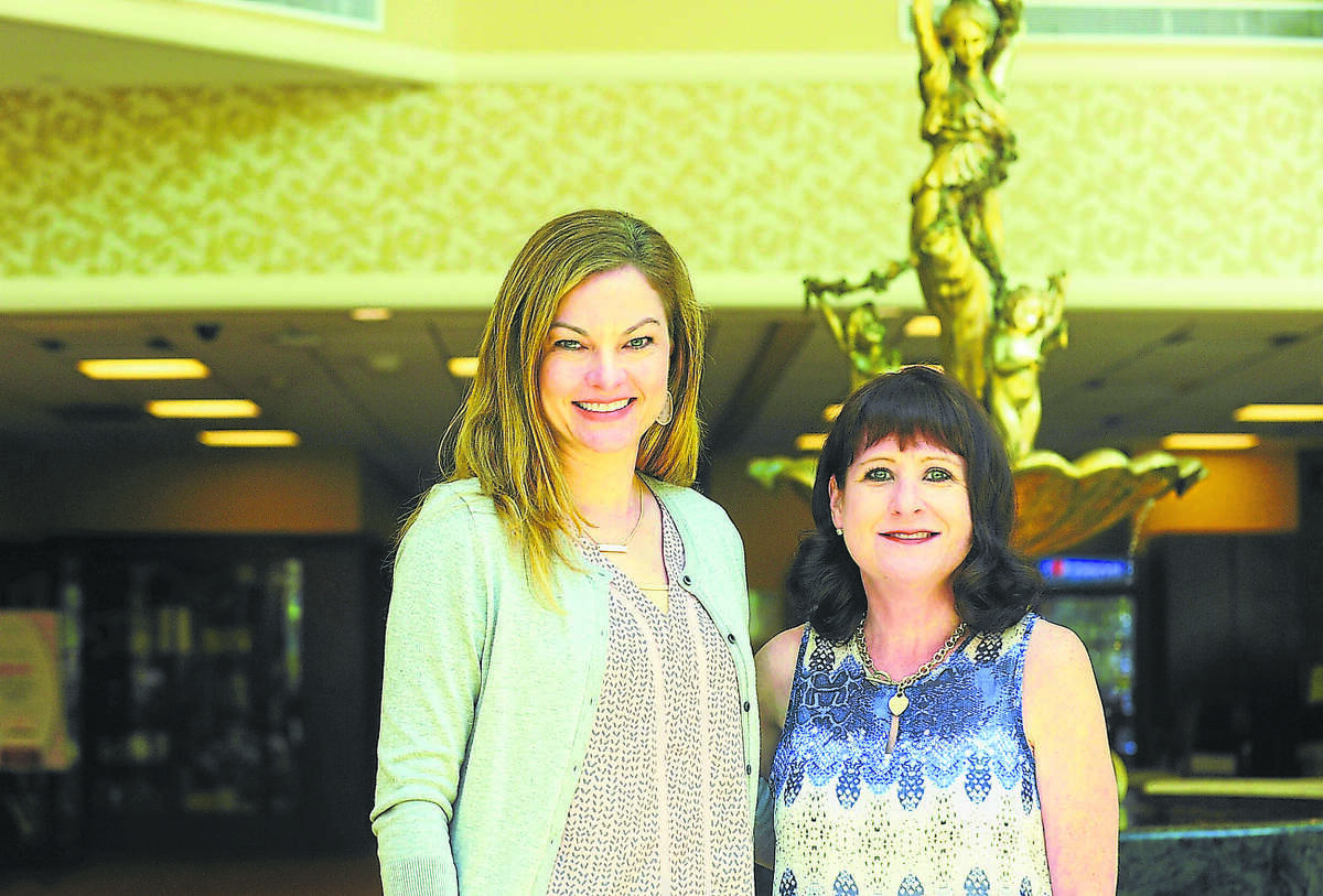 Rachel Fox, left, and Janet Pollard and are not oncologists or physicians, but the role they each play as counselors help facilitate the healing process for breast cancer patients who come to the North Cypress Medical Center in Cypress.