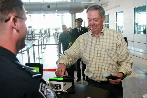 Passenger Rich Arnett uses the new Mobile Passport Control at Bush Intercontinental Airport. (For the Chronicle/Gary Fountain, September 30, 2016)