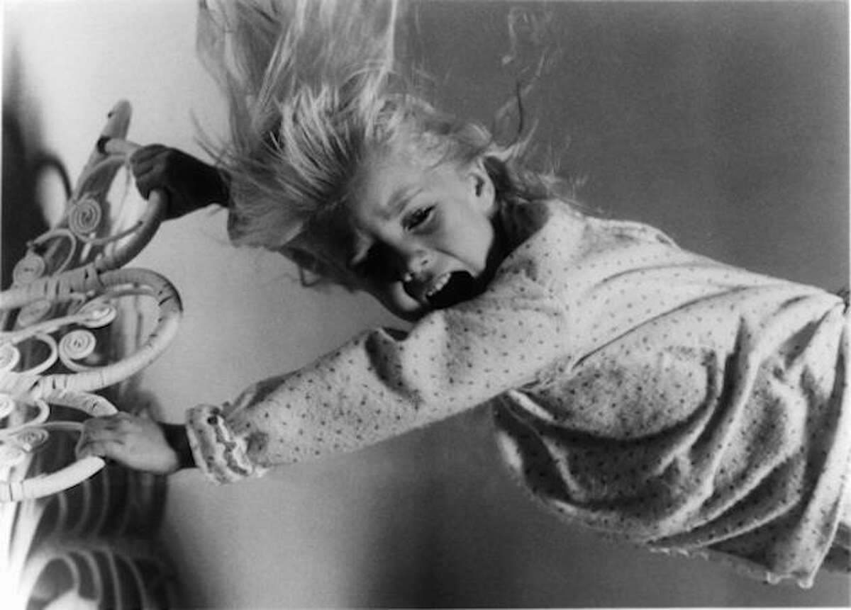 Poltergeist (1982) Little Carol Anne, played by Heather O'Rourke, sent chills down everyone's spine as the star of this early '80s ghost thriller. She reprised her role again in 1986 for Part II.