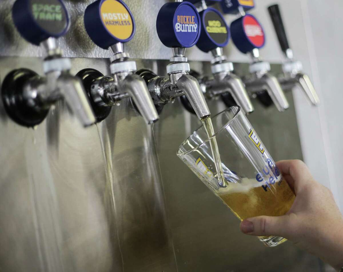 Texas breweries may soon be able to sell beer to go -- if the Senate approves new legislation by the end of session next week. ( Elizabeth Conley / Houston Chronicle )