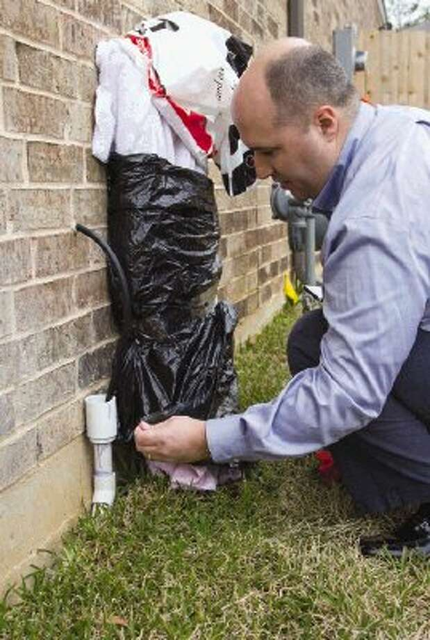 Wrap outdoor pipes and faucets with newspaper, foam, rags or other insulating material. To keep the insulation in place, secure it with string, wire or tape. Photo: Staff Photo By Ana Ramirez / The Conroe Courier