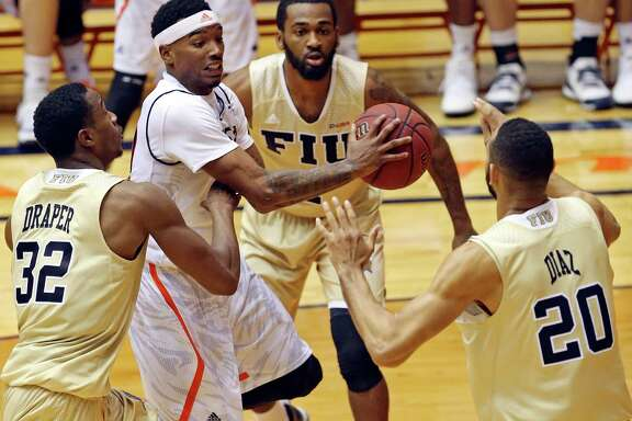 UTSA's Christian Wilson looks to pass between Florida International's Daviyon Draper (from left), Donte McGill and Adrian Diaz during second half action Thursday Jan. 21, 2016 at the Convocation Center. FIU won 72-56.