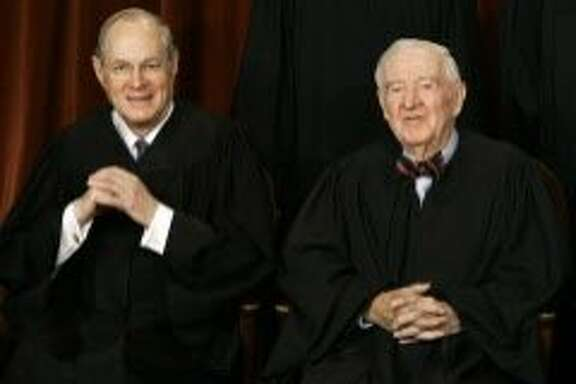Washington, UNITED STATES:  US Supreme Court justices Anthony Kennedy (L) and John Paul Stevens smile as the justices pose for their class photo 03 March 2006 inside the Supreme Court in Washington, DC.     AFP PHOTO/Paul J. RICHARDS  (Photo credit should read PAUL J. RICHARDS/AFP/Getty Images)