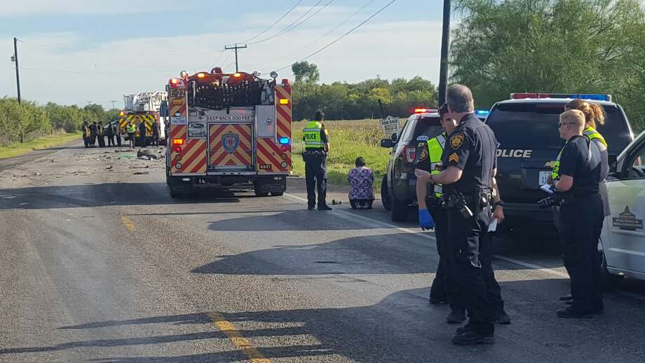 A woman kneels near the scene of a fatal accident on FM 1937 Friday. Photo: Jeremy Gerlach