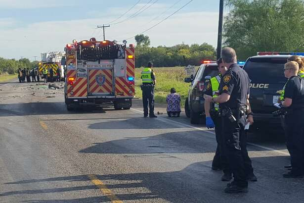 A woman kneels near the scene of a fatal accident on FM 1937 Friday.
