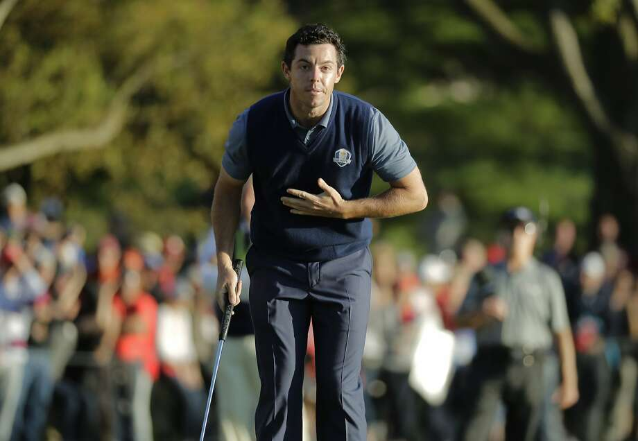 Rory McIlroy takes a sarcastic bow after holing a 20-foot eagle putt in Europe's afternoon comeback. Photo: Charlie Riedel, Associated Press