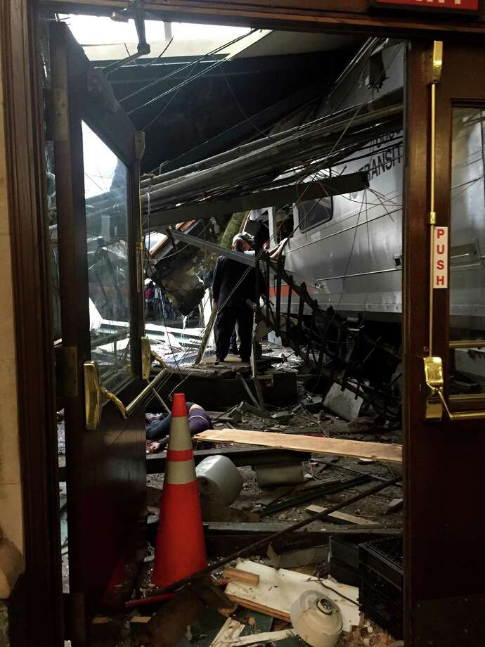 A NJ Transit train seen through the wreckage after it crashed into the platform at the Hoboken Terminal Thursday. Photo: Pancho Bernasconi / Getty Images / 2016 Getty Images