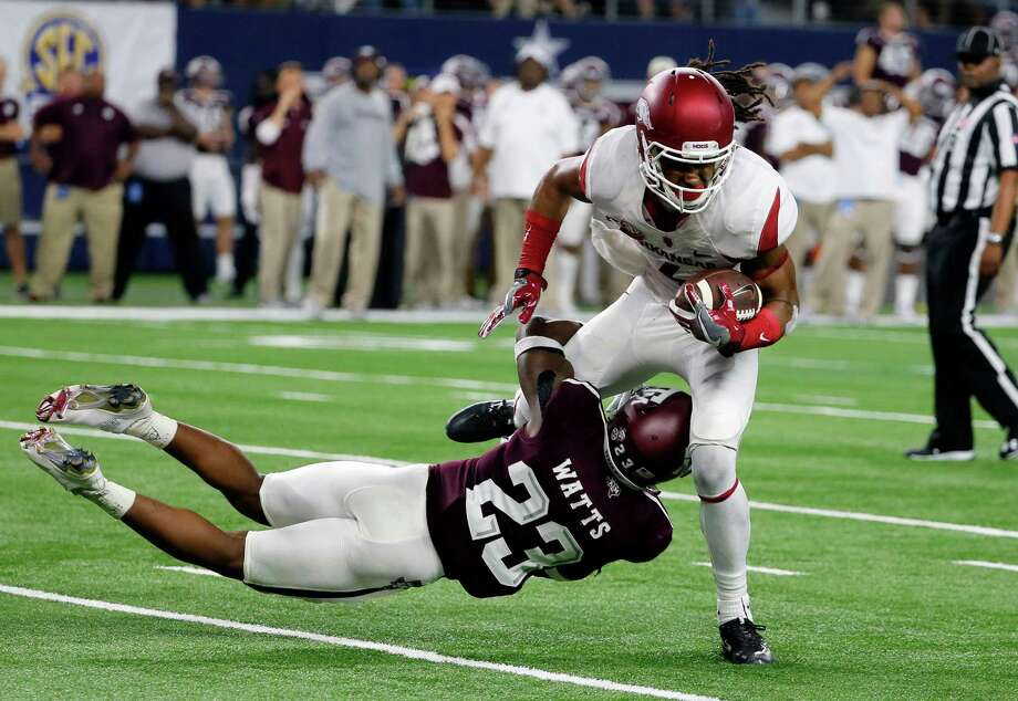 Texas A&M defensive back Armani Watts (23) stops Arkansas wide receiver Keon Hatcher on fourth down late in the second half on Sept. 24, 2016, in Arlington. Photo: Tony Gutierrez /Associated Press / Copyright 2016 The Associated Press. All rights reserved.