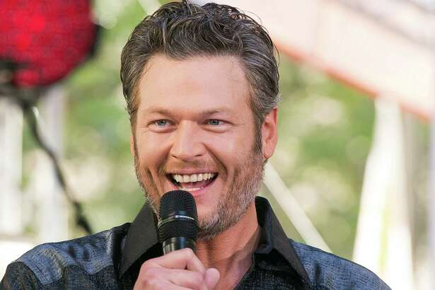 """FILE - In this Aug. 5, 2016 file photo, Blake Shelton performs on NBC's """"Today"""" show at Rockefeller Plaza in New York. Shelton apologized on Twitter for offending people with his language, but denied being hateful after several old tweets referencing gays and non-English speakers surfaced online. Screenshots of years-old tweets posted on his Twitter account, which he controls, prompted criticism online that """"The Voice"""" judge was sexist to women and stereotyping gay people and non-English speakers. (Photo by Charles Sykes/Invision/AP, File) ORG XMIT: NYET370"""