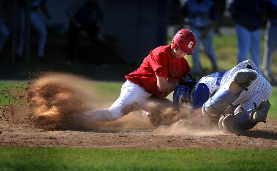 Fairfield Ludlowe catcher Rob Ferrara forces Greenwich's Callum Lawson out at home plate during their game Wednesday May 5, 2010 at Kiwanis field in Fairfield. Photo: Autumn Driscoll / Connecticut Post