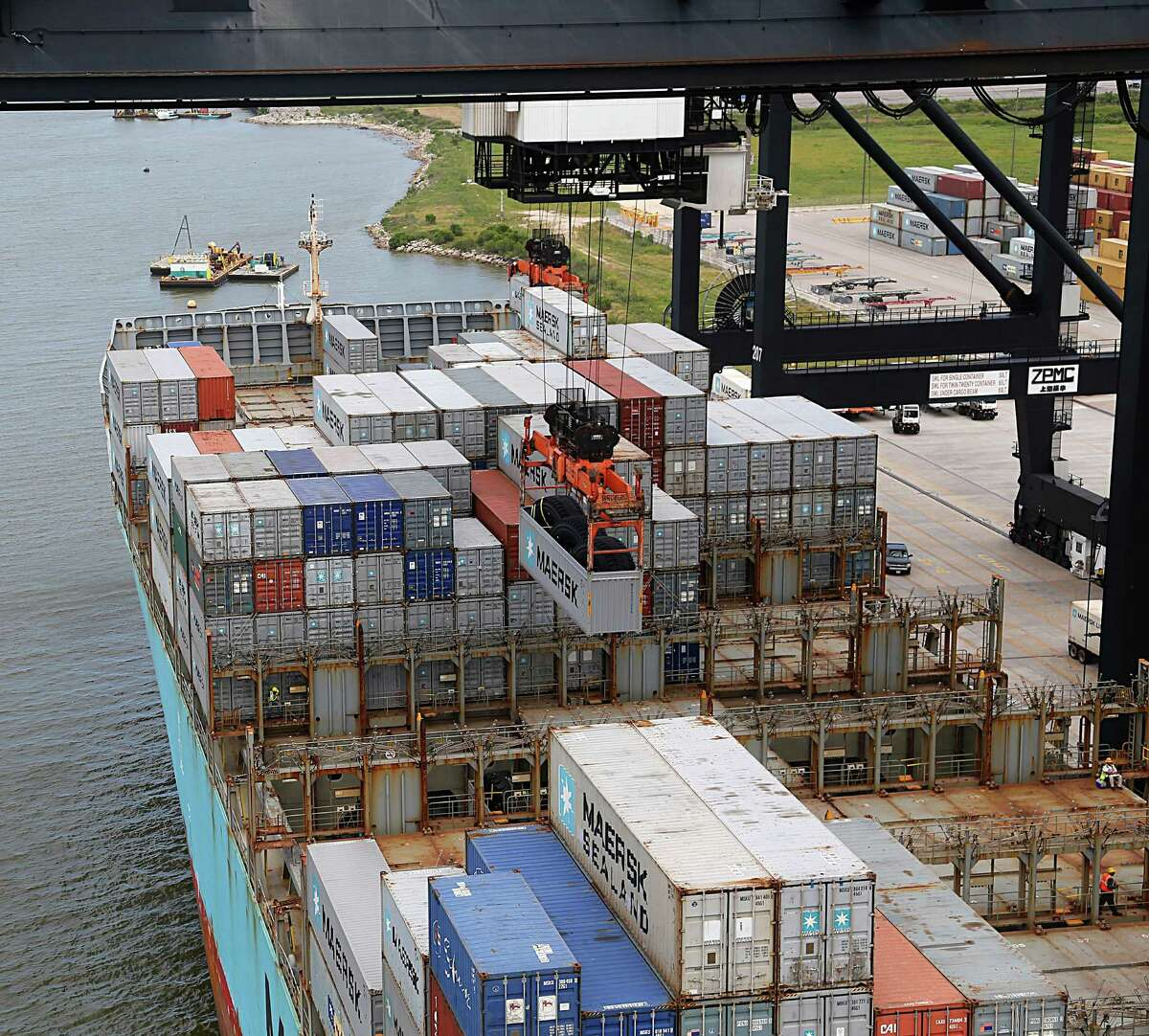 A crane unloads a container from a ship at the Bayport Container Terminal in Seabrook.