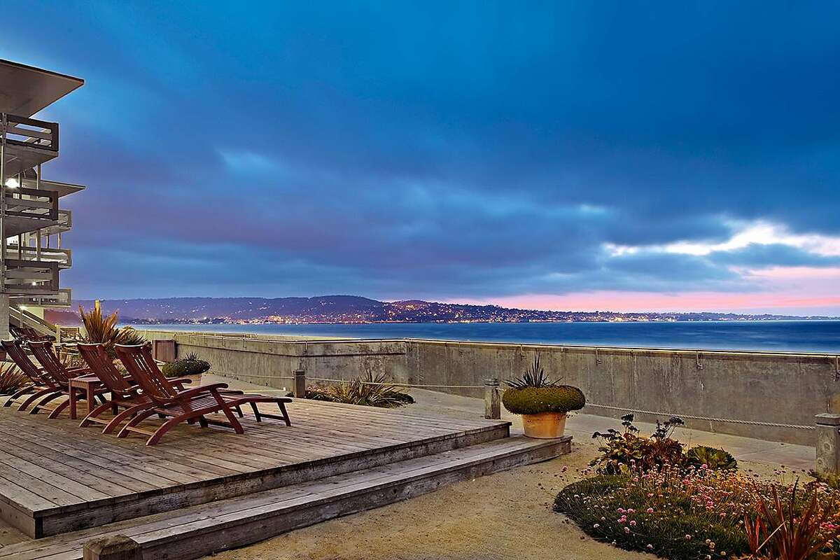 The Monterey Tides hotel is unusual in that it not only has a view of the beach, it owns the beach, or at least a wide enough swath that allows it to host weddings and hold bonfires on the sand.