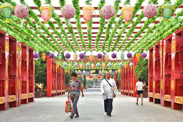 Visitors are bathed in colour on the long bridge which leads to Dragon Pavilion.