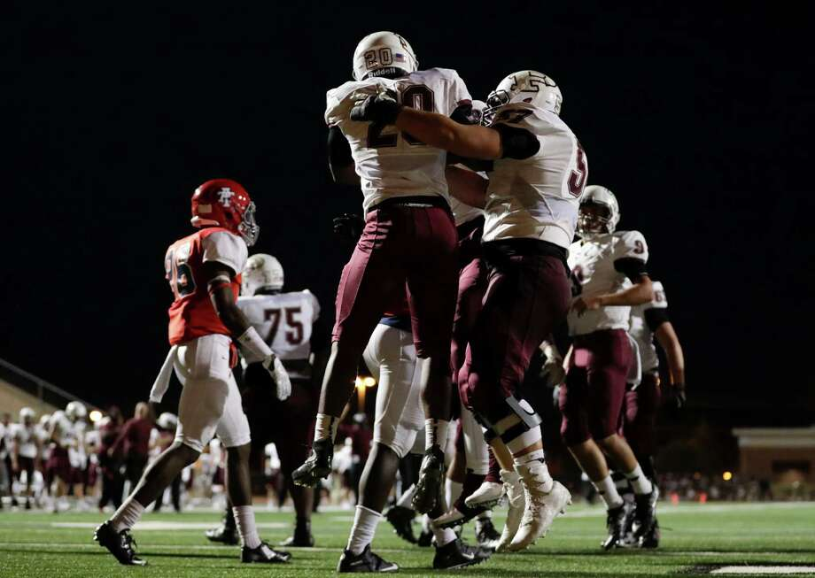 Pearland Oilers running back Evan Burgess (20) celebrates with teammates after scoring a touchdown during the high school football game between the Pearland Oilers and the Alief Taylor Lions at Crump Stadium in Houston, TX on Friday, September 30, 2016.  The Oilers lead the Lions 14-7 at halftime. Photo: Tim Warner, For The Chronicle / Houston Chronicle