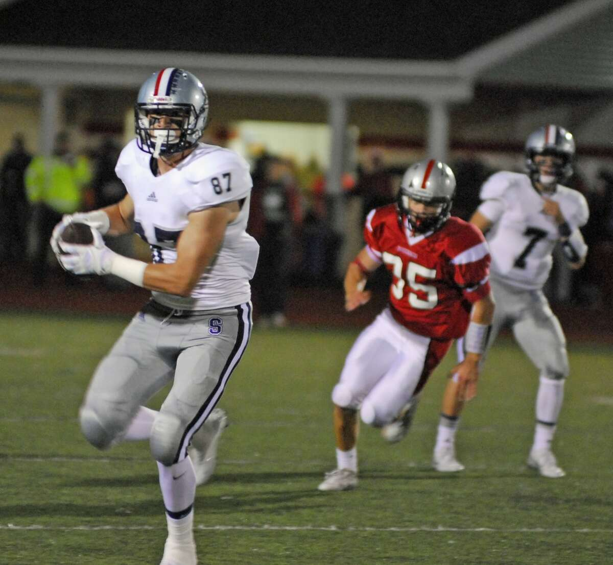 Staples tight end Ryan Fitton runs with the ball after a catch against Warde on Friday in Fairfield.