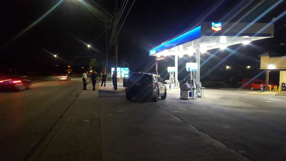A man was found with at least two gunshot wounds Friday evening near a gas station in the 6400 block of Wurzbach Road. Photo: Jeremy Gerlach