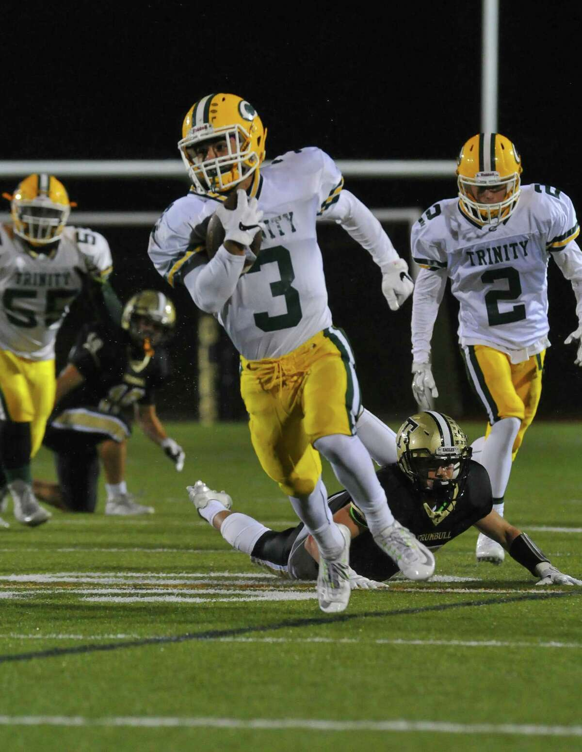 Jonmichael Bivona (3) of the Trinity Catholic Crusaders carries the ball up field during a game against the Trumbull Eagles on September 30, 2016 at Trumbull High School in Trumbull, Connecticut.