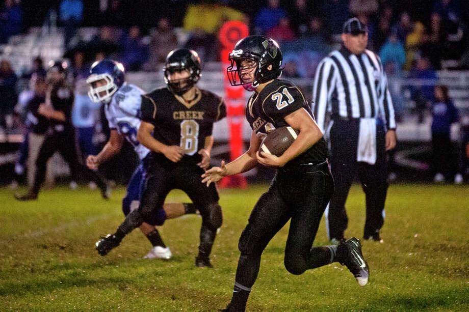 ERIN KIRKLAND | ekirkland@mdn.net  Bullock Creek running back Travis Radosa runs the ball on Friday against Swan Valley at Bullock Creek High School. Radosa rushed for 72 yards.