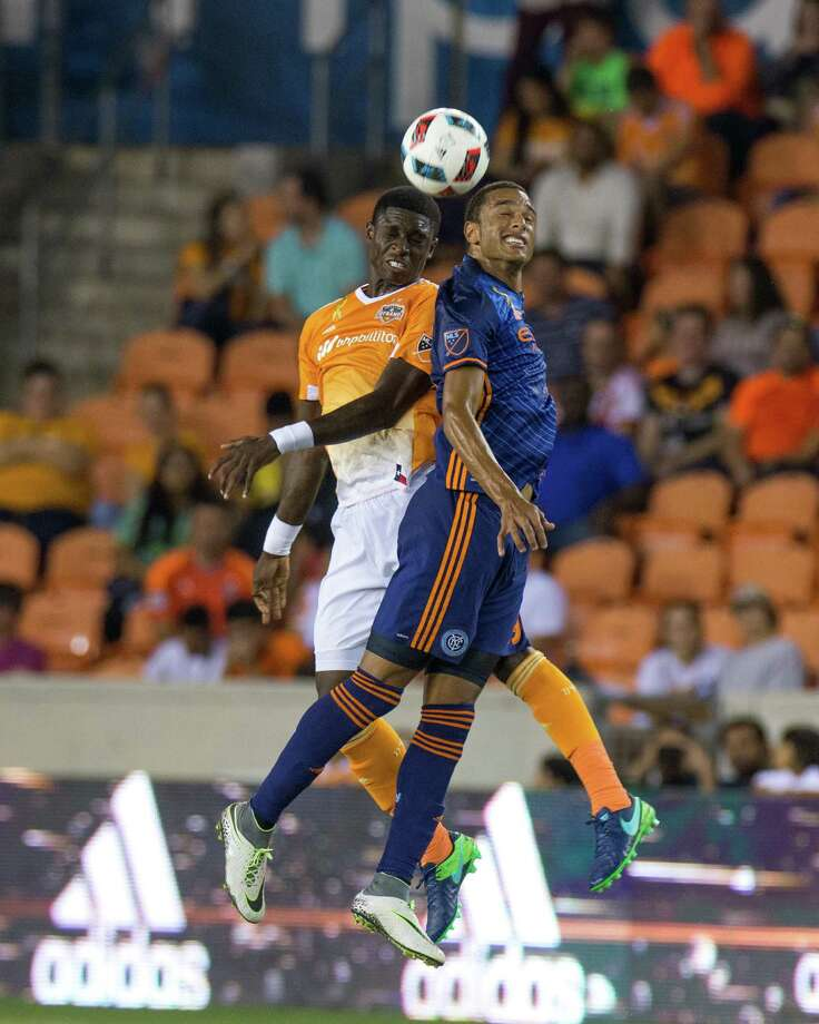 New York City FC forward Khiry Shelton (19) and Houston Dynamo midfielder Ricardo Clark (13) go up for the ball during the second half of action between the Houston Dynamo and the New York City FC during an MLS soccer game at BBVA Compass, Friday, September 30, 2016, in Houston. New York City FC defeated Houston Dynamo 2-0. (Juan DeLeon/Houston Chronicle ) Photo: Juan DeLeon, For The Chronicle / Houston Chronicle