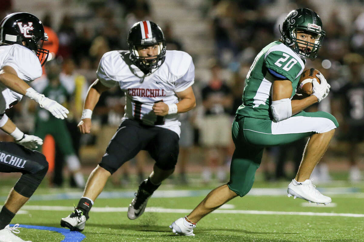 reagan's Eric Sierra (right) looks for a running lane after catching a pass as Churchill's Andy DeLeon defends during the second half of their District 26-6A high school football game at Comalander Stadium on Friday, Sept. 30, 2016. Reagan beat Churchill 31-6. MARVIN PFEIFFER/ mpfeiffer@express-news.net