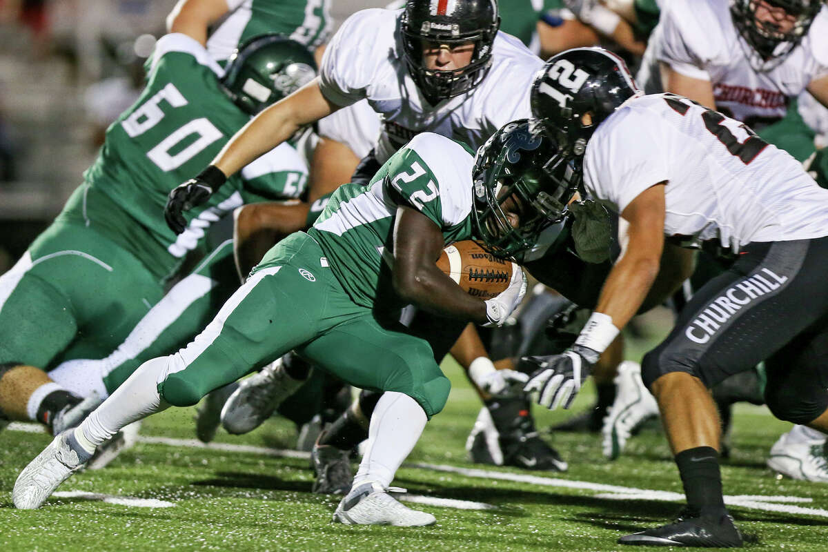 Reagan's Marquis Duncan runs into the Churchill defense during the first half of their District 26-6A high school football game at Comalander Stadium on Friday, Sept. 30, 2016. MARVIN PFEIFFER/ mpfeiffer@express-news.net