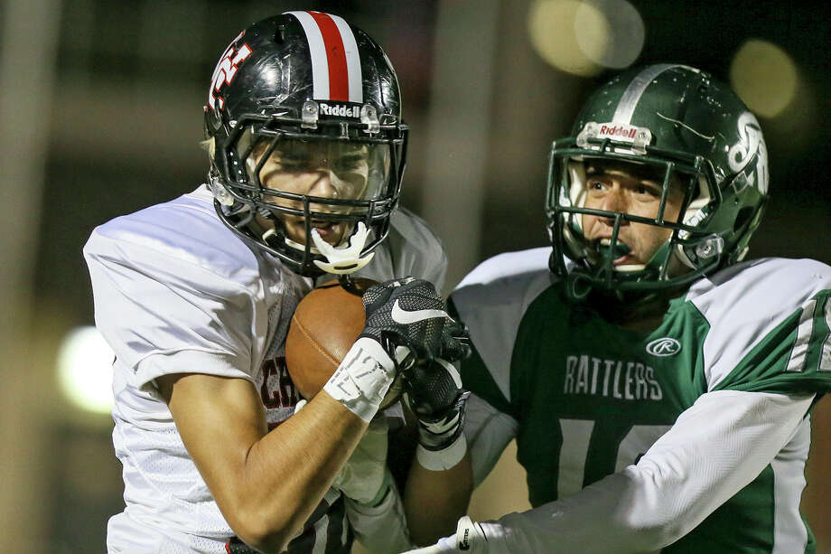 Churchill's Liam Capobianco (left) catches a pass over Reagan's Spencer Heath for a 34-yard touchdown during the second half of their District 26-6A high school football game at Comalander Stadium on Friday, Sept. 30, 2016. Reagan beat Churchill 31-6.  MARVIN PFEIFFER/ mpfeiffer@express-news.net Photo: Marvin Pfeiffer/San Antonio Express-News