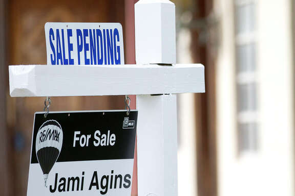 "FILE - In this Thursday, Jan. 8, 2015, file photo, a ""Sale Pending"" sign sits atop a realty sign outside a home for sale in Surfside, Fla. On Thursday, Sept. 29, 2016, the National Association of Realtors releases its July report on pending home sales, which are seen as a barometer of future purchases. (AP Photo/Wilfredo Lee, File)"