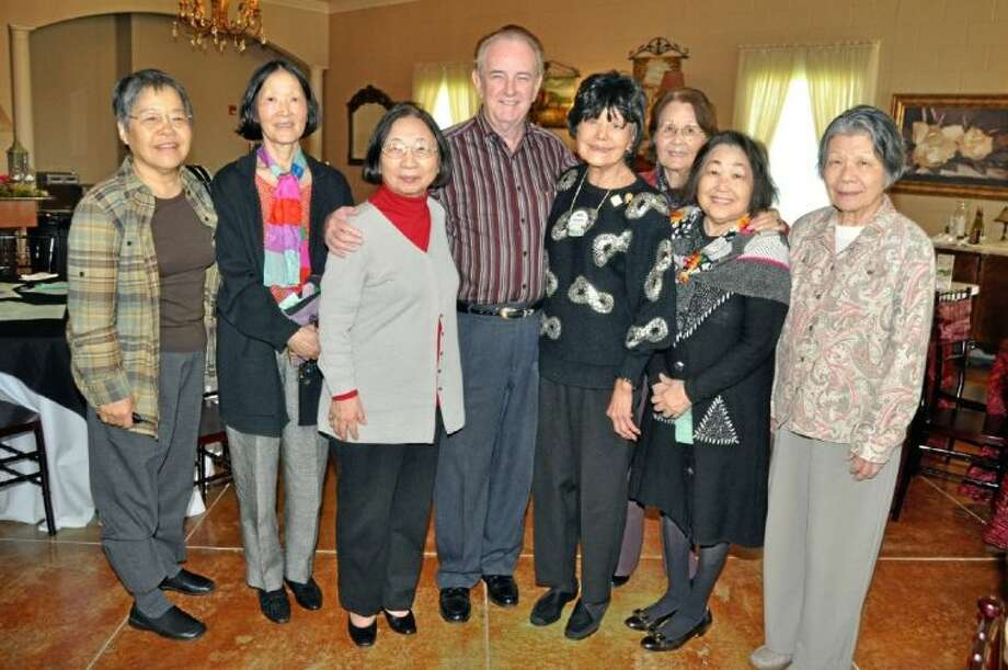 Mayor Johnny Isbell and Reiko Denison, fifth from left visit with Japanese guests living in the Pasadena/Houston area at the Pasadena South Rotary luncheon meeting, which was held at the Silver Sycamore.