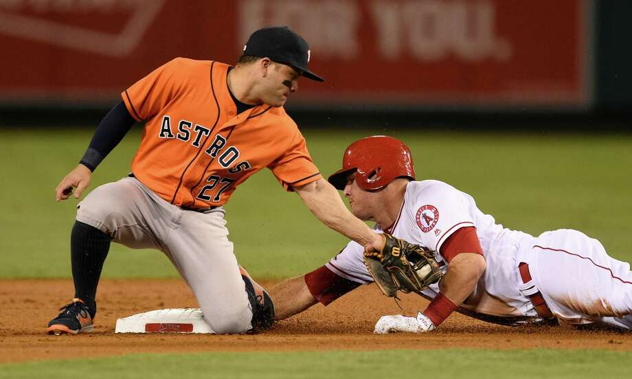 The Angels' Mike Trout, right, beats Astros second baseman Jose Altuve's tag to the bag in the first inning Friday night in Anaheim, Calif. Altuve got his 213th hit of the season and Trout his club-record 114th walk during the Angels' 7-1 victory. Photo: Kelvin Kuo, FRE / FR170752 AP