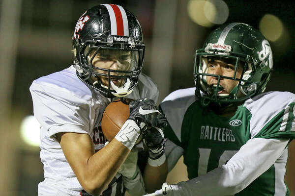 Churchill's Liam Capobianco (left) catches a pass over Reagan's Spencer Heath for a 34-yard touchdown during the second half of their District 26-6A high school football game at Comalander Stadium on Friday, Sept. 30, 2016. Reagan beat Churchill 31-6.  MARVIN PFEIFFER/ mpfeiffer@express-news.net