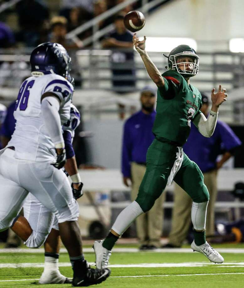 The Woodlands quarterback Eric Schmid (3) is chased out of the pocket by Lufkin defensive lineman Carl Williams (96) as he throws a 20-yard touchdown pass to receiver Connor Klapesky during the third quarter of a 12-6A football game at Woodforest Bank Stadium on Friday, Sept. 30, 2016, in Houston. Photo: Brett Coomer, Houston Chronicle / © 2016 Houston Chronicle