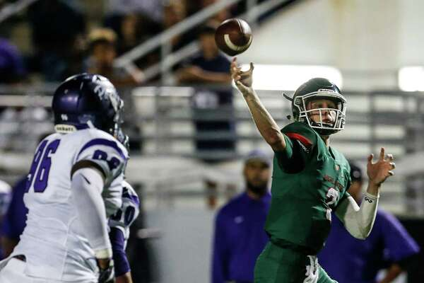 The Woodlands quarterback Eric Schmid (3) is chased out of the pocket by Lufkin defensive lineman Carl Williams (96) as he throws a 20-yard touchdown pass to receiver Connor Klapesky during the third quarter of a 12-6A football game at Woodforest Bank Stadium on Friday, Sept. 30, 2016, in Houston.