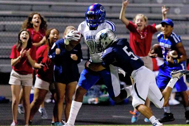West Brook wide receiver Damon Ward (88) hauls in a pass down the sideline as College Park defensive back Zachary Cantu (5) defends during the second quarter of a District 12-6A high school football game Friday, Sept. 30, 2016, in Conroe.