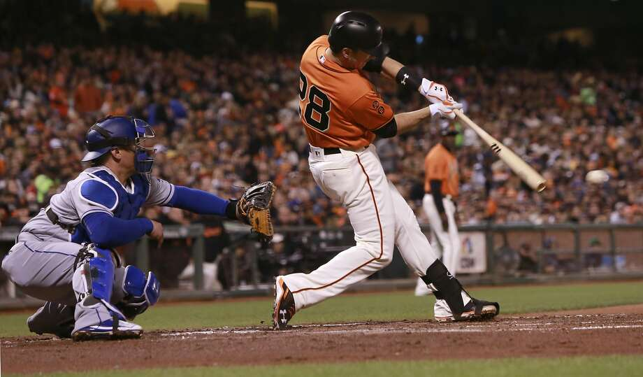 Giants' Buster Posey singles in a run in the first inning, as the an Francisco Giants take on the Los Angeles Dodgers at AT&T Park  in San Francisco , California on Fri. Sept. 30, 2016. Photo: Michael Macor, The Chronicle