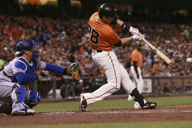 Giants' Buster Posey singles in a run in the first inning, as the an Francisco Giants take on the Los Angeles Dodgers at AT&T Park  in San Francisco , California on Fri. Sept. 30, 2016.